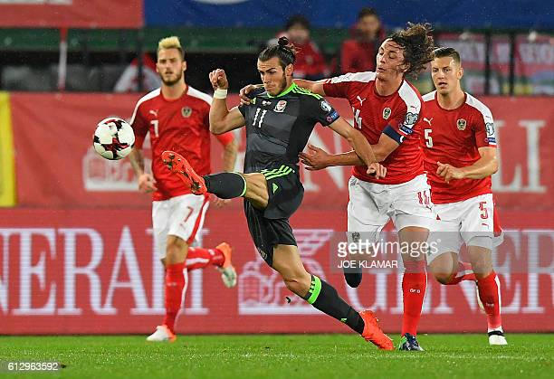 TOPSHOT Gareth Bale of Wales vies with Austrian captain Julian Baumgartlinger during the WC 2018 football qualification match between Austria and...