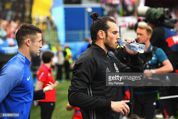 Gareth Bale of Wales walks into the pitch prior to the UEFA EURO 2016 Group B match between England and Wales at Stade BollaertDelelis on June 16...