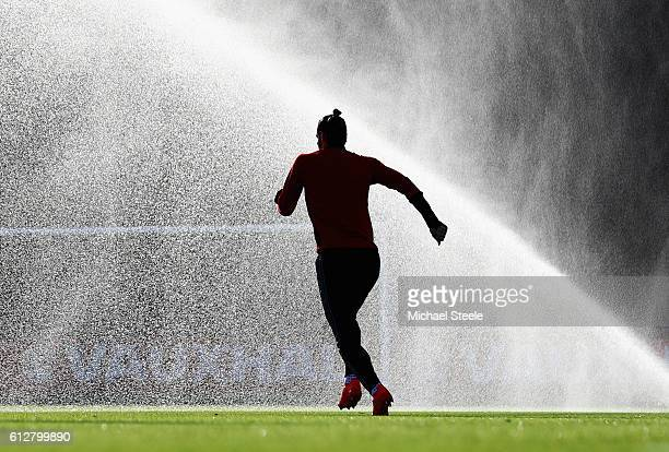Gareth Bale of Wales warms up during a training session at Vale Resort on October 5 2016 in Cardiff Wales