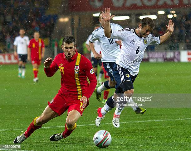 Gareth Bale of Wales wins a penalty following a challenge from Shaun Maloney of Scotland during the FIFA 2014 World Cup Qualifying Group A match...