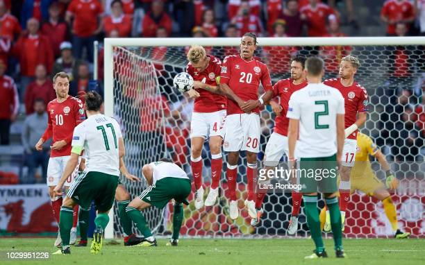 Gareth Bale of Wales with a freekick hitting Simon Kjar of Denmark during the UEFA Nations League match between Denmark and Wales at Ceres Park on...