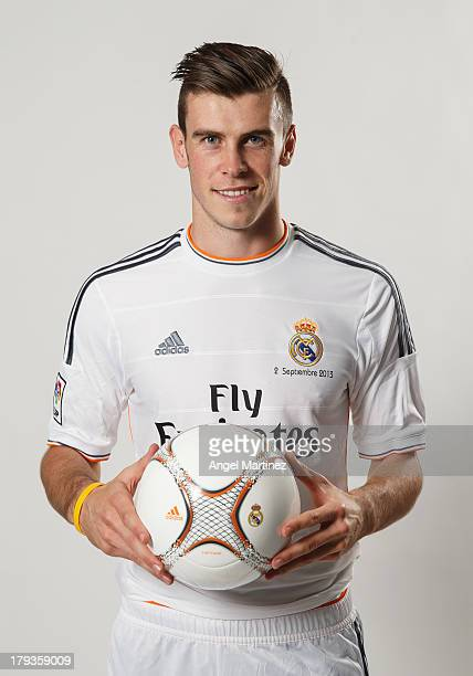 Gareth Bale poses during his official presentation as a new Real Madrid player at Estadio Santiago Bernabeu on September 2 2013 in Madrid Spain