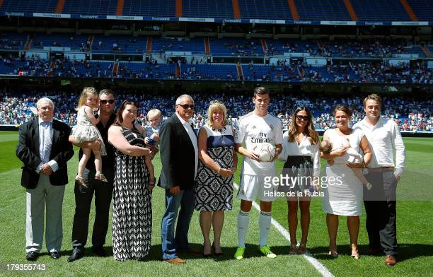 Gareth Bale poses with his family during the official presentation as a new Real Madrid player at Estadio Santiago Bernabeu on September 2 2013 in...