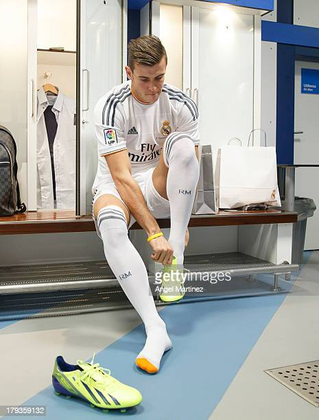 Gareth Bale puts on his boots before his official presentation as a new Real Madrid player at Estadio Santiago Bernabeu on September 2 2013 in Madrid...