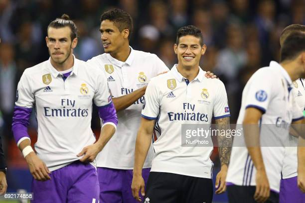 Gareth Bale Raphael Varane and James Rodriguez of Real Madrid the UEFA Champions League Final between Juventus and Real Madrid at National Stadium of...