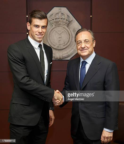 Gareth Bale shakes hands with Real Madrid's President Florentino Perez during his official presentation as a new Real Madrid player at Estadio...