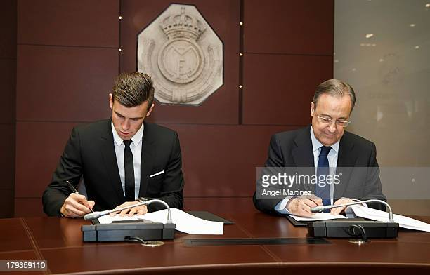 Gareth Bale signs his contract with Real Madrid's President Florentino Perez during his official presentation as a new Real Madrid player at Estadio...