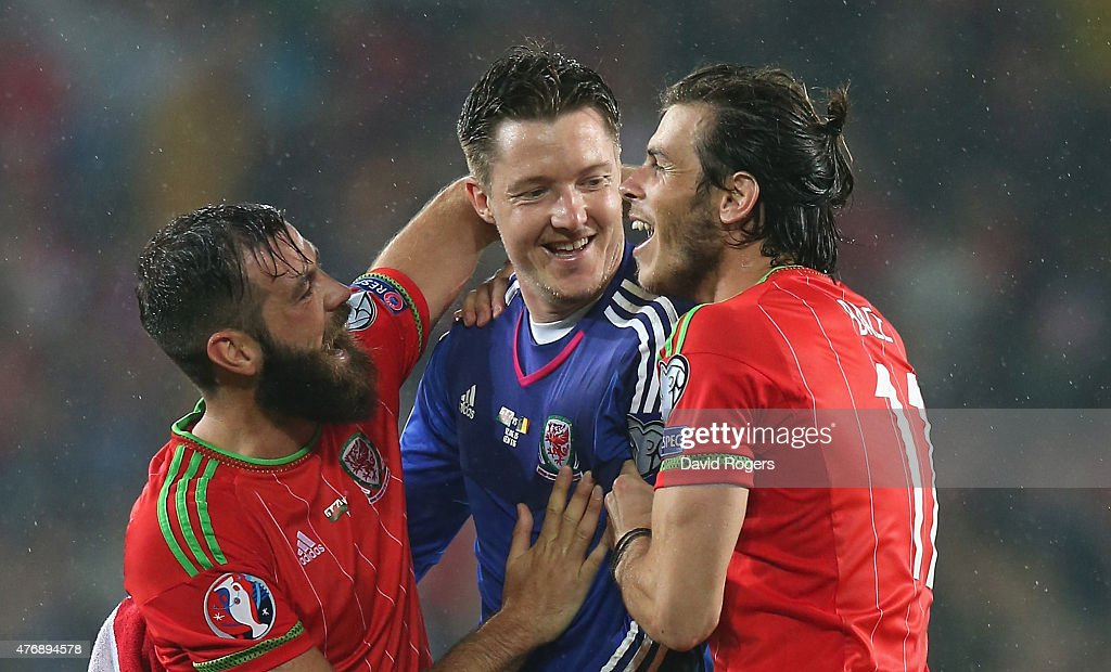 Gareth Bale, (R) who scored the winning for Wales celebrates with team mates Wayne Hennessey (C) and Joe Ledley after their victory during the UEFA EURO 2016 qualifying match between Wales and Belgium at the Cardiff City Stadium on June 12, 2015 in Cardiff, United Kingdom.