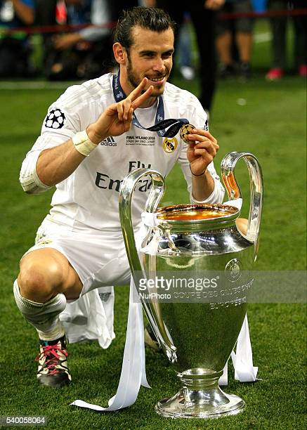 Gareth Bale with the trophy during celebrations at the end of the Champions League final between Real Madrid CF and Club Atletico de Madrid at the...