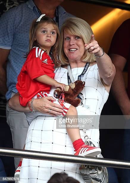 Gareth Bale's mother Deborah Bale holds granddaughter Alba Bale in her arms during the UEFA Euro 2016 Round of 16 match between Wales and Northern...