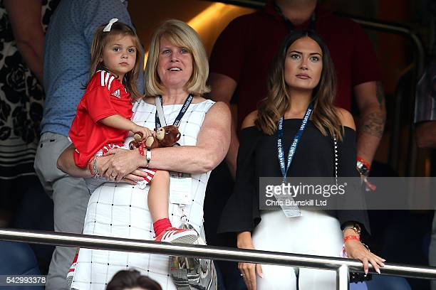 Gareth Bale's mother Deborah Bale holds granddaughter Alba Bale in her arms as girlfriend EmmaRhys Jones looks on during the UEFA Euro 2016 Round of...