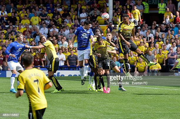 Gareth Barry challenging for header during the Premier League match between Everton and Watford at Goodison Park on August 08 2015 in Liverpool...