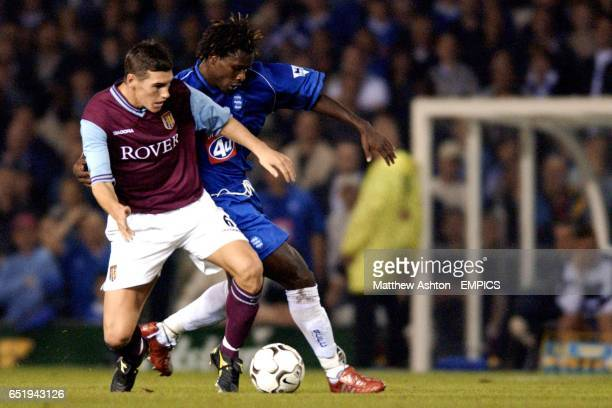 Gareth Barry of Aston Villa and Aliou Cisse of Birmingham City battle for the ball