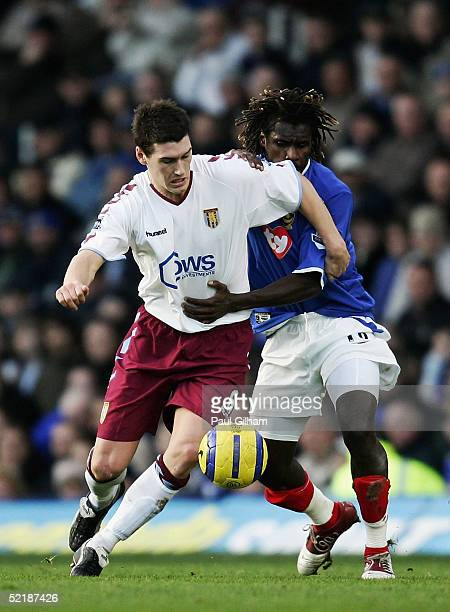 Gareth Barry of Aston Villa batles for the ball with Aliou Cisse of Portsmouth during the Barclays Premiership match between Portsmouth and Aston...