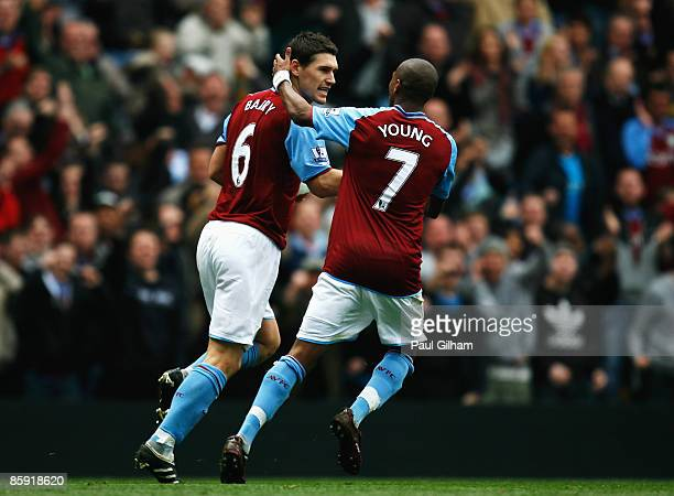 Gareth Barry of Aston Villa celebrates with Ashley Young after scoring a penalty to level the game 3-3 during the Barclays Premier League match...