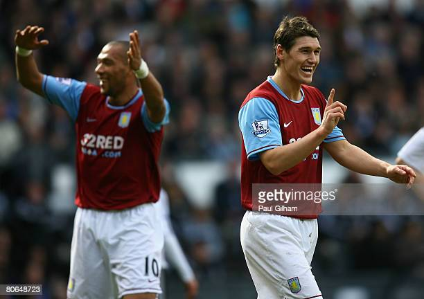 Gareth Barry of Aston Villa celebrates with Gabriel Agbonlahor and Ashley Young after scoring the fourth goal for Aston Villa during the Barclays...