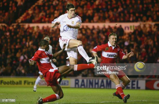 Gareth Barry of Aston Villa is put under pressure by George Boateng and Tony McMahon of Middlesbrough during the FA Barclays Premiership match...