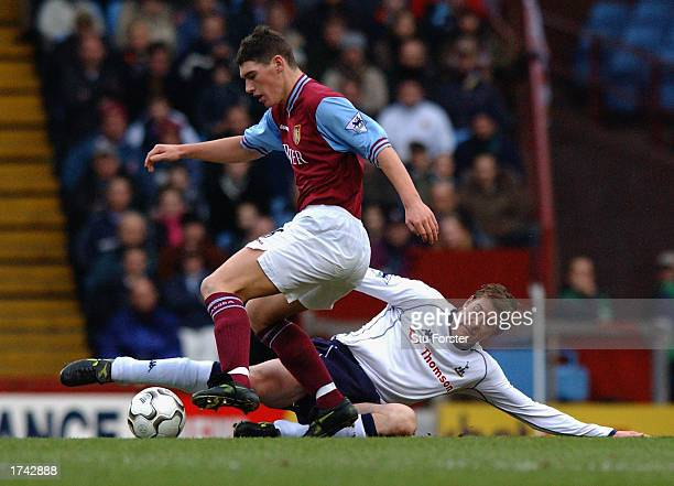 Gareth Barry of Aston Villa is tackled by Darren Anderton of Tottenham Hotspur during the FA Barclaycard Premiership match held on January 18 2003 at...