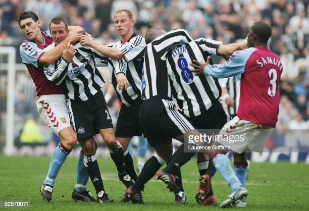 Gareth Barry of Aston Villa pulls apart Newcastle's Lee Bowyer and Kieron Dyer as they come to blows during the FA Barclays Premiership match between...