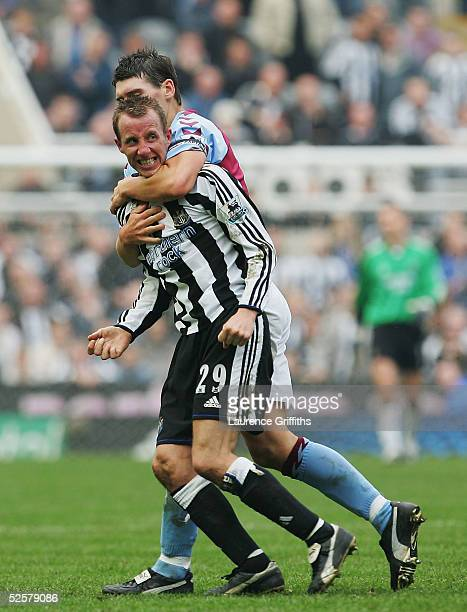Gareth Barry of Aston Villa restrains Lee Bowyer after he came to blows with team mate Kieron Dyer of Newcastle during the FA Barclays Premiership...
