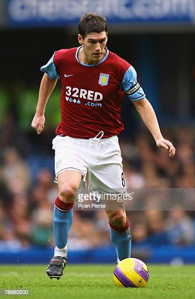 Gareth Barry of Aston Villa runs with the ball during the Barclays Premier League match between Chelsea and Aston Villa at Stamford Bridge on...