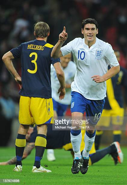 Gareth Barry of England celebrates after his header was deflected off the head of Daniel Majstorović of Sweden to score their first goal during the...