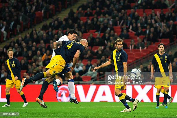 Gareth Barry of England helps score the opening goal with a header that then deflected off Daniel Majstorović of Sweden during the international...
