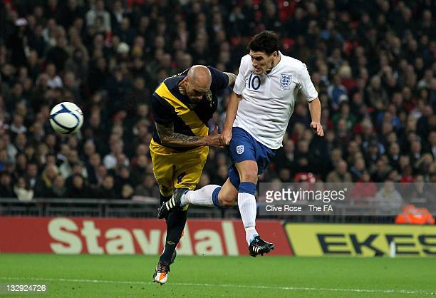 Gareth Barry of England helps score the opening goal with a header that was then deflected off Daniel Majstorović of Sweden during the...