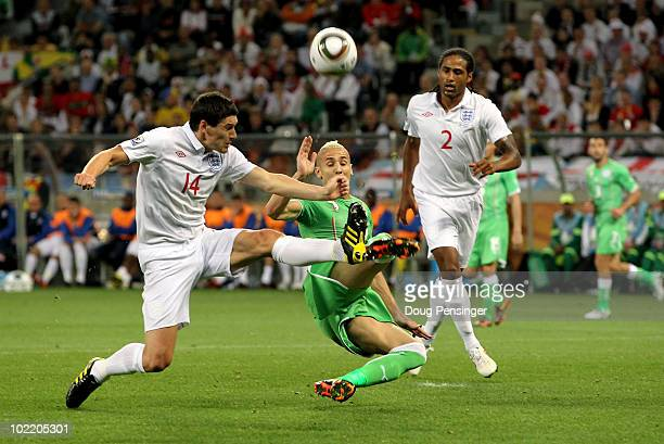 Gareth Barry of England tackles Hassan Yebda of Algeria during the 2010 FIFA World Cup South Africa Group C match between England and Algeria at...