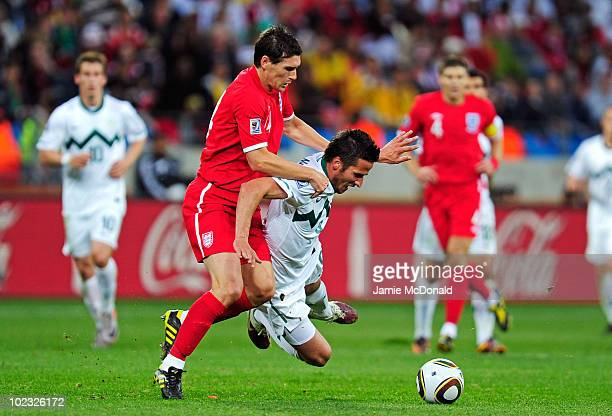 Gareth Barry of England tackles Zlatan Ljubijankic of Slovenia during the 2010 FIFA World Cup South Africa Group C match between Slovenia and England...