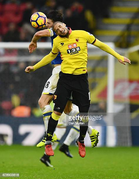 Gareth Barry of Everton and Adlene Guedioura of Watford jump for the ball during the Premier League match between Watford and Everton at Vicarage...
