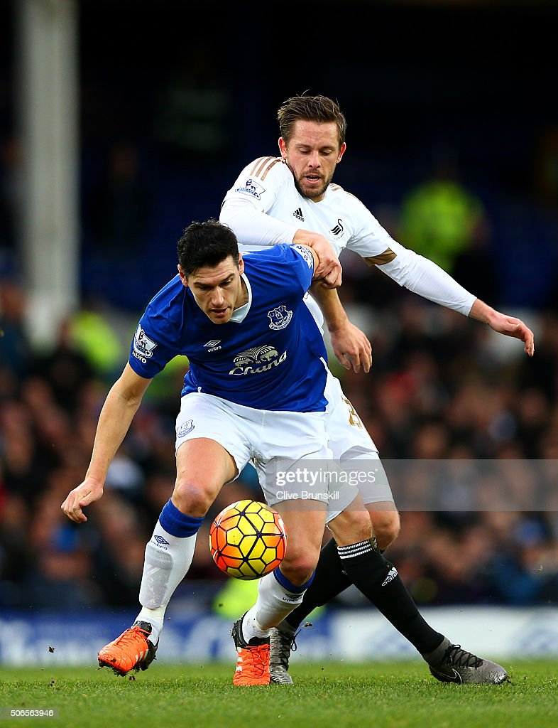 Gareth Barry of Everton battles for the ball with Gylfi Sigurdsson of Swansea City during the Barclays Premier League match between Everton and Swansea City at Goodison Park on January 24, 2016 in Liverpool, England.