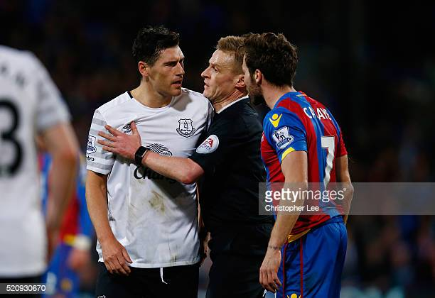Gareth Barry of Everton exchanges words with Yohan Cabaye of Crystal Palace as he is held back by referee Mike Jones during the Barclays Premier...