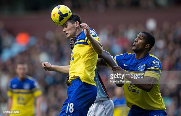 Gareth Barry of Everton goes for a header against Christian Benteke of Aston Villa during the Barclays Premier League match between Aston Villa and...
