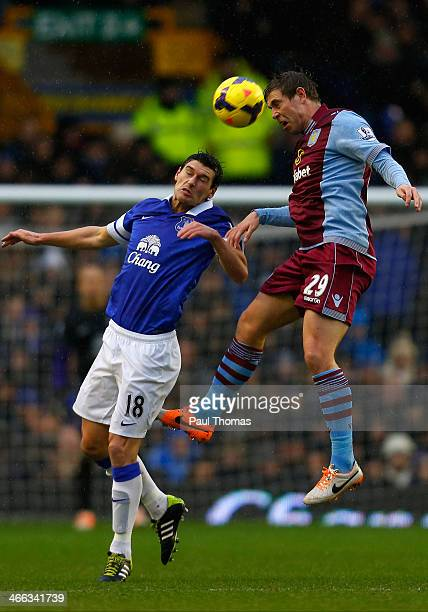 Gareth Barry of Everton in action with Grant Holt of Aston Villa during the Barclays Premier League match between Everton and Aston Villa at Goodison...