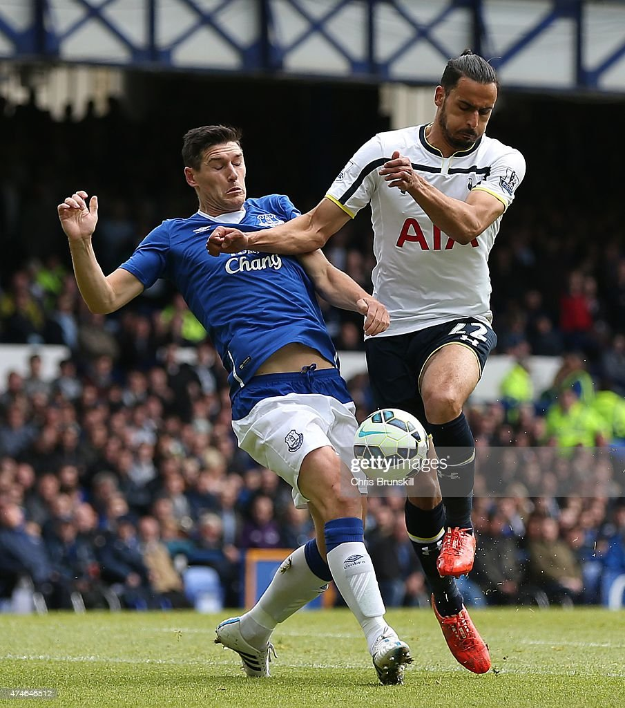 Gareth Barry of Everton in action with Nacer Chadli of Tottenham Hotspur during the Barclays Premier League match between Everton and Tottenham Hotspur at Goodison Park on May 24, 2015 in Liverpool, England.