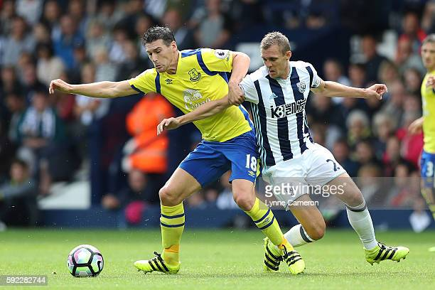 Gareth Barry of Everton is tackled by Darren Fletcher of West Bromwich Albion during the Premier League match between West Bromwich Albion and...