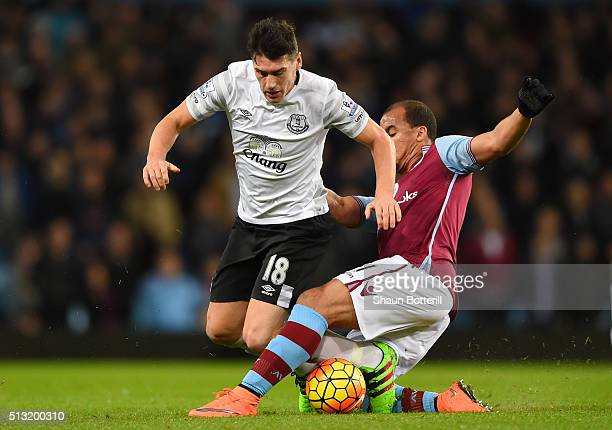 Gareth Barry of Everton is tackled by Gabriel Agbonlahor of Aston Villa during the Barclays Premier League match between Aston Villa and Everton at...