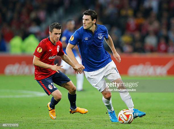 Gareth Barry of Everton is watched by Sebastien Corchia of Lille during the UEFA Europa League Group H match between LOSC Lille and Everton at Grand...