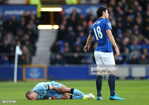 Gareth Barry of Everton reacts as Pablo Zabaleta of Manchester City lies injured during the Barclays Premier League match between Everton and...