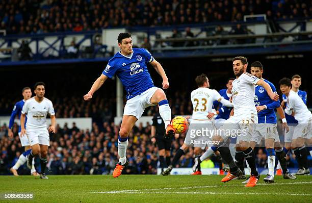 Gareth Barry of Everton scores his team's first goal during the Barclays Premier League match between Everton and Swansea City at Goodison Park on...