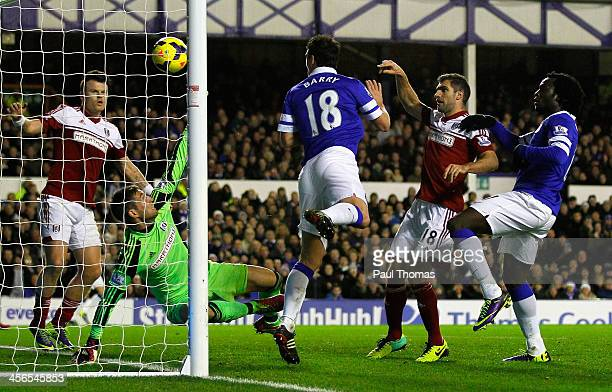 Gareth Barry of Everton scores his team's third goal during the Barclays Premier League match between Everton and Fulham at Goodison Park on December...