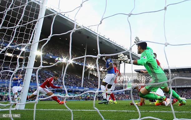 Gareth Barry of Everton scores their first goal on his 600th Premier League appearance past goalkeeper Victor Valdes of Middlesbrough during the...