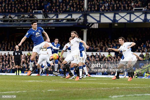 Gareth Barry of Everton scores there first goal during the Barclays Premier League match between Everton and Swansea City at Goodison Park on January...
