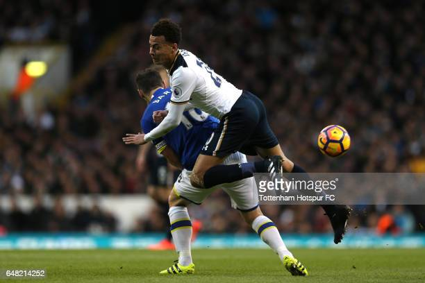 Gareth Barry of Everton tackles Dele Alli of Tottenham Hotspur during the Premier League match between Tottenham Hotspur and Everton at White Hart...
