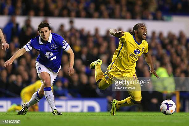 Gareth Barry of Everton trips Cameron Jerome of Crystal Palace during the Barclays Premier League match between Everton and Crystal Palace at...