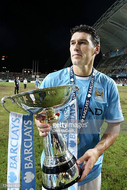 Gareth Barry of Manchester City celebrates after defeating Sunderland during the Barclays Asia Trophy Final match between Manchester City and...