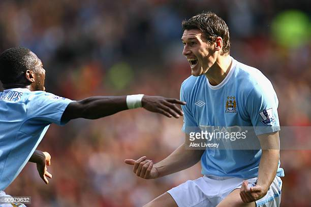 Gareth Barry of Manchester City celebrates scoring his team's first goal with team mate Shaun Wright Phillips during the Barclays Premier League...
