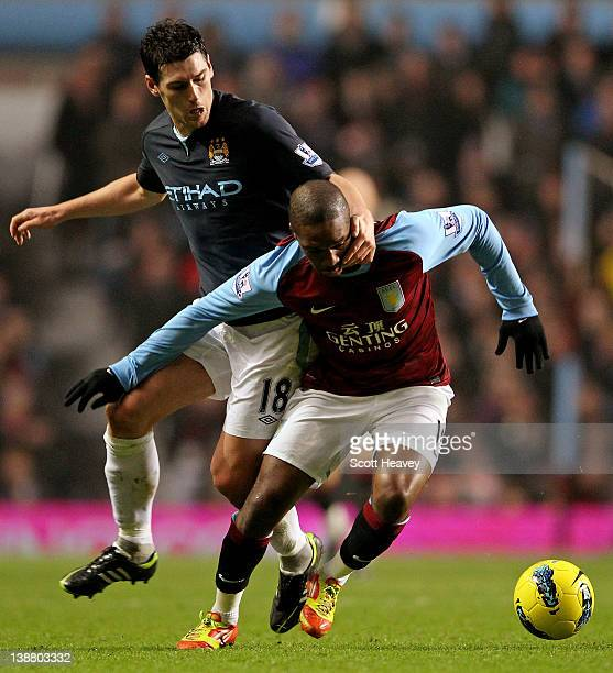 Gareth Barry of Manchester City challenges Charle N'Zogbia of Aston Villa during the Barclays Premier League match between Aston Villa and Manchester...