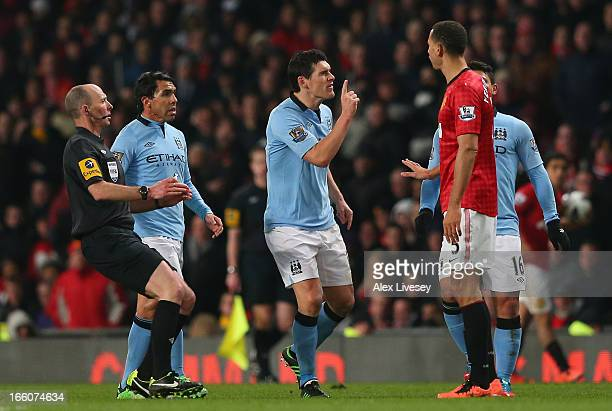 Gareth Barry of Manchester City clashes with Rio Ferdinand of Manchester United during the Barclays Premier League match between Manchester United...